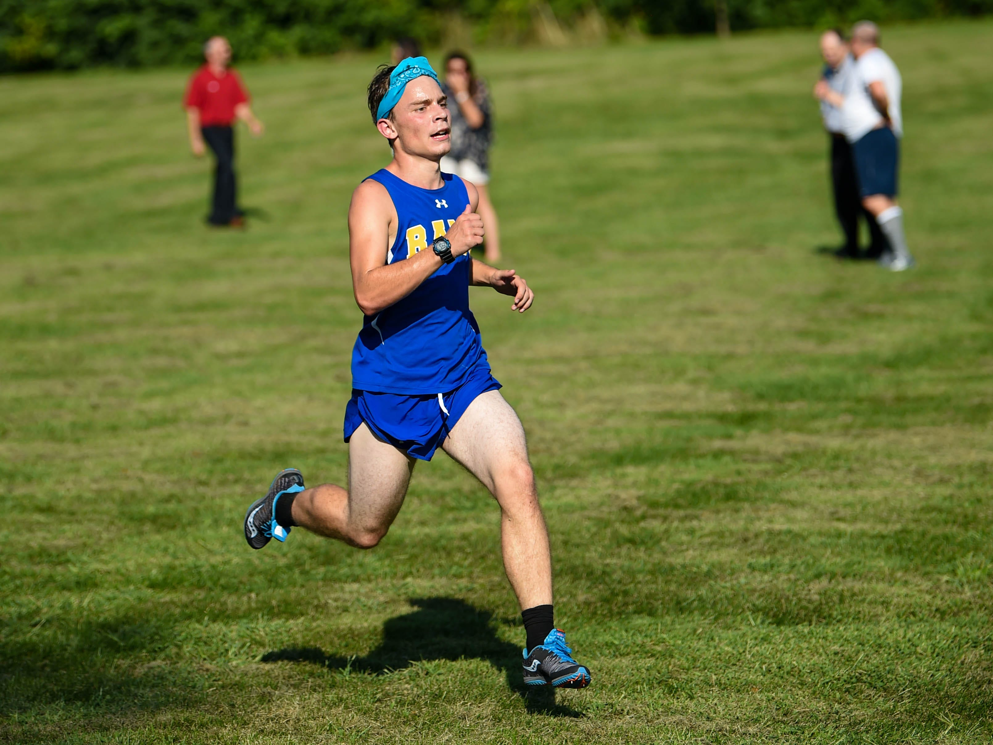 Kennard-Dale sprints to the finish during the Cross Country scrimmage at John Rudy County Park on August 30, 2018.