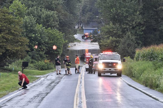 Emergency crews respond to Freysville Road in Hellam Township, where heavy rain caused flooding on Friday.