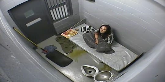 Kelly Coltrain sits in a cell at the Mineral County Jail in Hawthorne. She died about an hour after her jailer asked her to mop her vomit from the floor.