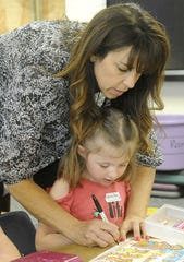 Yerington Elementary School kindergarten teacher helps a student.