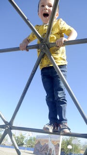 A Fernley Elementary School pre-kindergartner plays during recess.