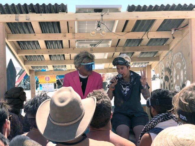 "From left, Rev. Billy Talen of the Church of Stop Shopping and Natalie ""Ethos"" deLeon give a crowd of people a talk about consent and boundaries at the Foam Against the Machine human foam wash theme camp at Burning Man 2018. DeLeon talked about boundaries and that the camp is not a sexy camp, it is a cleaning camp for dirty burners to learn about acceptance and consent. ""Nudity is not consent,"" she told the group."""