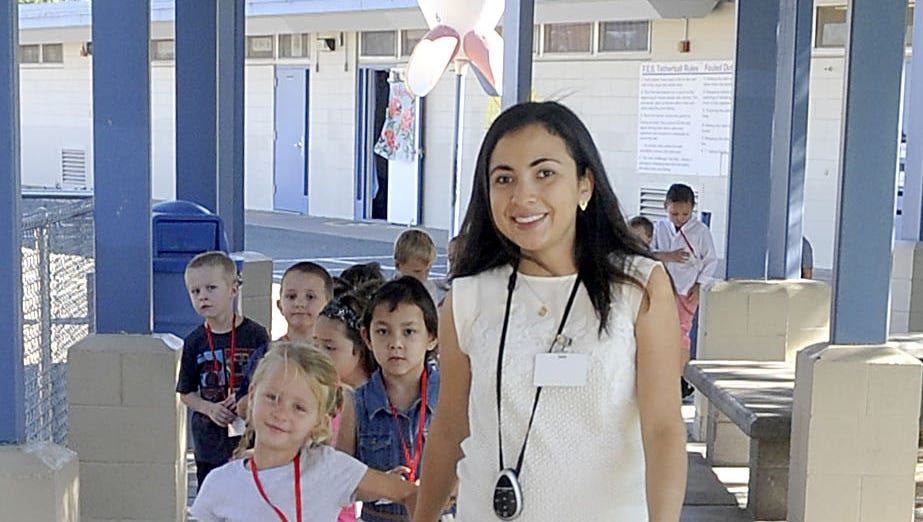 Fernley Elementary School kindergarten teacher Geraldine Diaz takes her students on a tour of the school.
