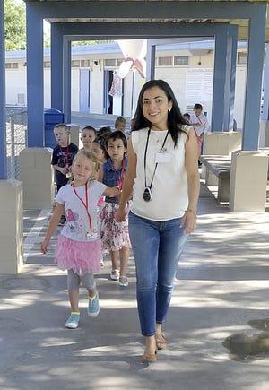 Fernley Elementary School kindergarten teacher Geraldine Diaz takes her students on a tour of the school.