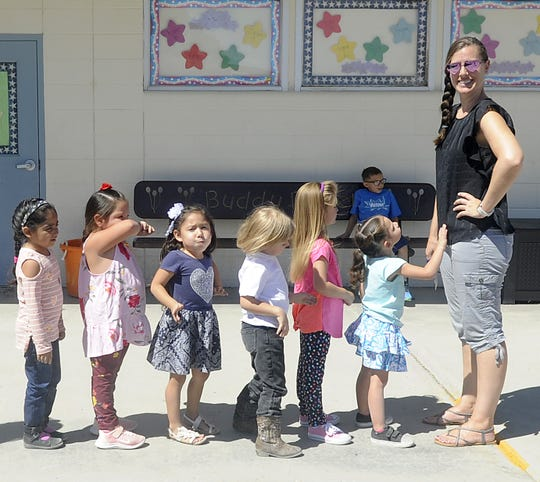 Yerington Elementary School pre-kindergarten teacher Jerilee Kent lines up her students.