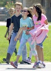 Yerington Elementary School students walk across the playground.