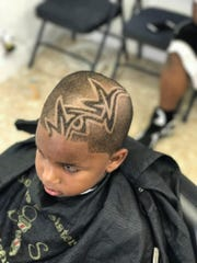 Zion Williams received a fresh cut at Brothers and Sisters Unisex Salon on Dewey Avenue.