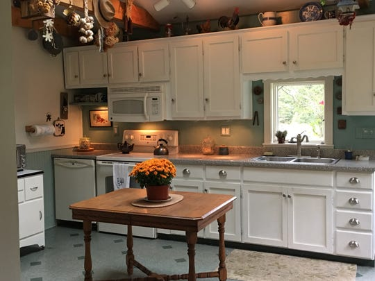 The kitchen in their new home fits the setting with rustic touches.