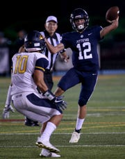 Pittsford quarterback Matt LaRocca throws a pass as Pittsford's Matt LaRocca provides the defense in the season-opening Teddi Bowl on Aug. 31.