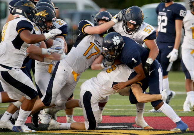 Victor's defense swarms to take down Pittsford's Lavontae Bonds in the season-opening Teddi Bowl on Aug. 31.