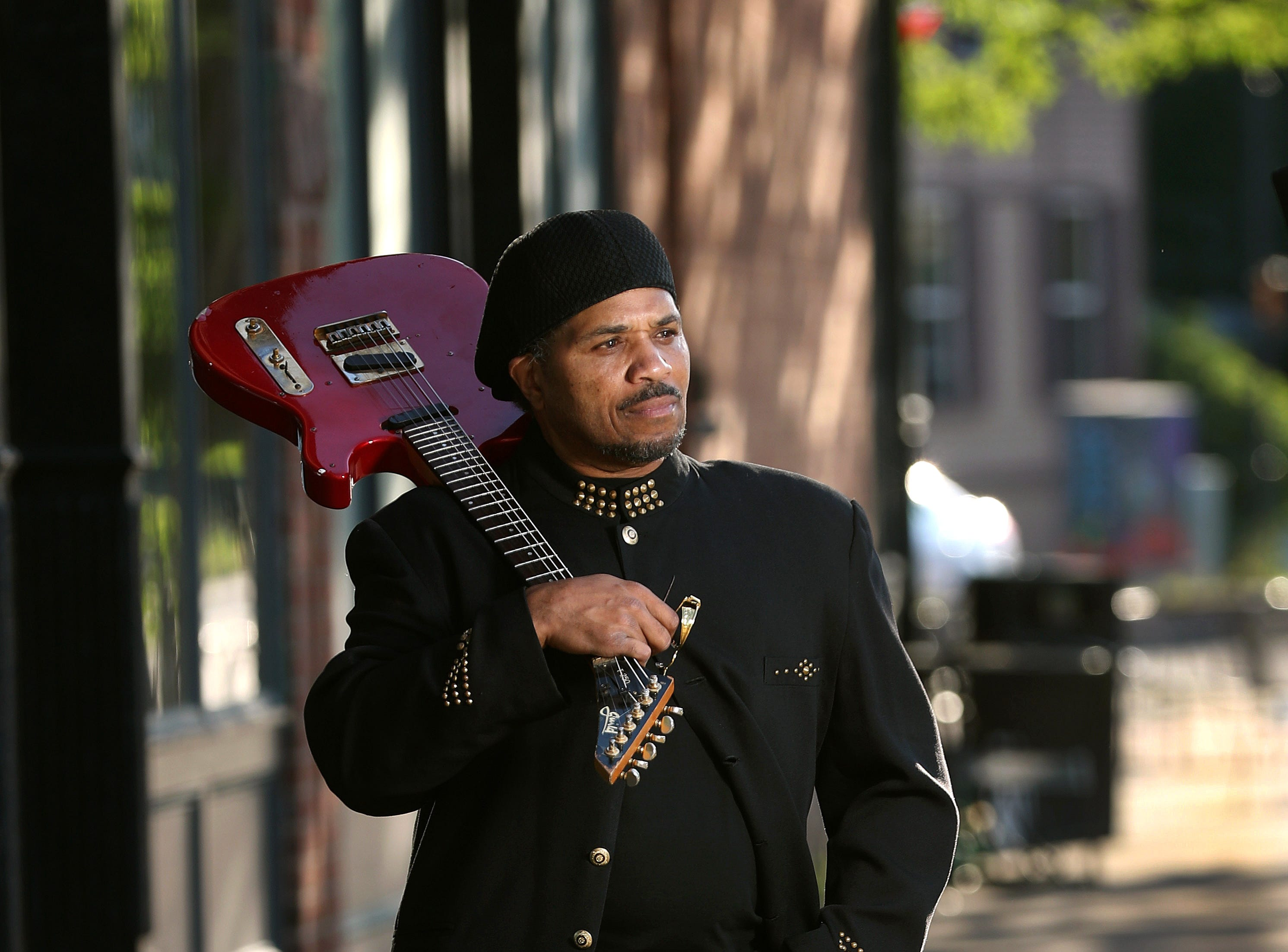 Brother Wilson with his guitar on Atlantic Avenue.