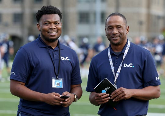Democrat and Chronicle high school sports reporters Stevie Johnson and James Johnson at the Teddi Bowl on Thursday night.