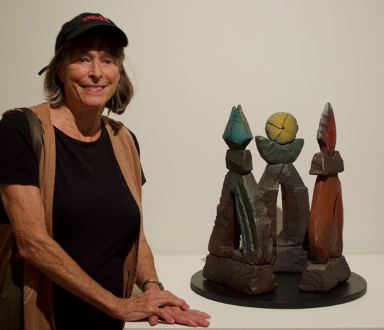 "Sculptor Nancy Jurs  is pictured beside a model of ""Triad:  Gateway to Rochester.""   Her exhibit continues this week at Memorial Art Gallery."