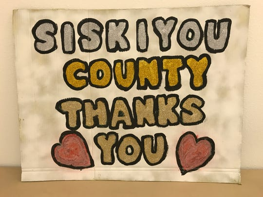 A sign shows thanks inside the Dunsmuir Community Center where fire officials held a meeting on the Hirz Fire.