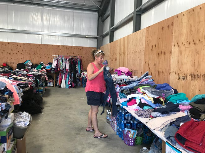 Melissa Elliott sorts donated clothing for Carr Fire victims. She and her husband Jim started the grassroots effort on Facebook in July.