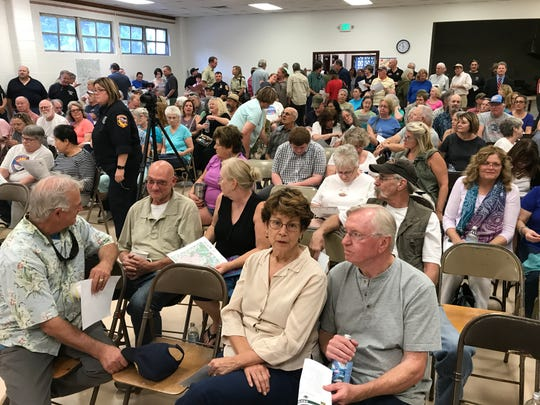 About 150 people concerned about the Hirz Fire burning about 12 miles southeast of Dunsmuir attend a community meeting in Dunsmuir on Thursday evening.