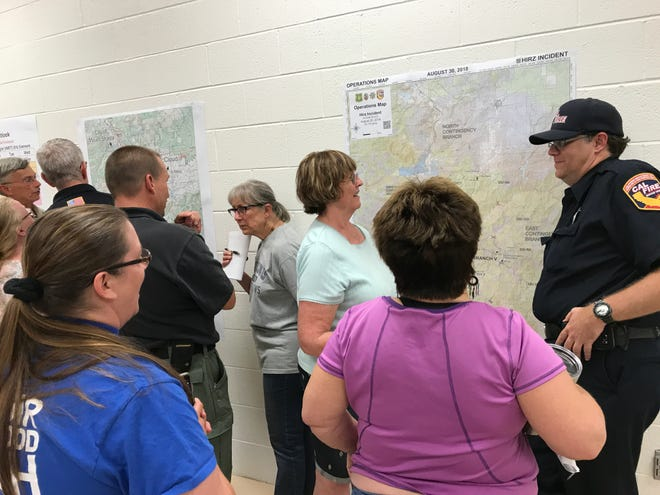 Fire officials answer questions Thursday evening at a Hirz Fire meeting inside the Dunsmuir Community Center.