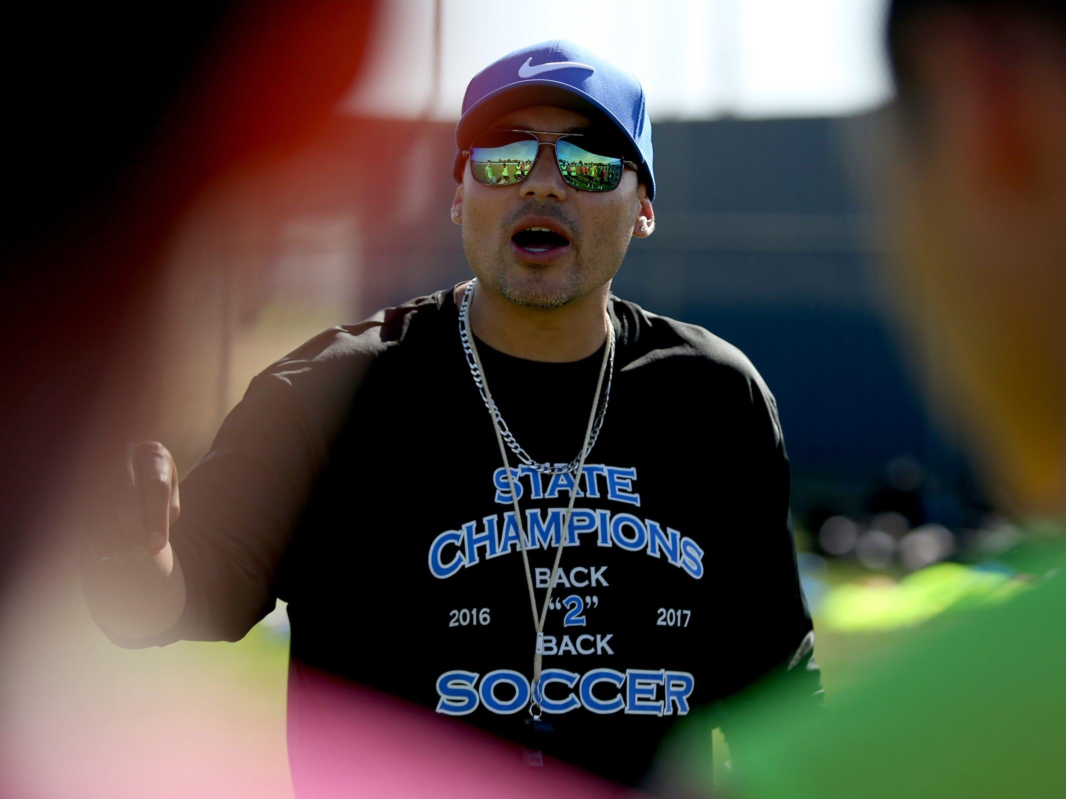 Boys soccer head coach Leroy Sanchez leads a practice at Woodburn High School on Wednesday, Aug. 29, 2018.