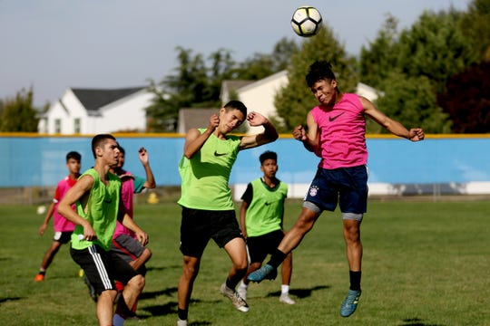 Boys soccer practice at Woodburn High School on Wednesday, Aug. 29, 2018.