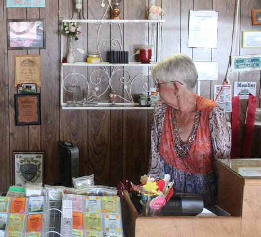 Judy Fowler, owner of Candles Handmade by JF, operating the front desk at her location at 2716 Sherwood Way.