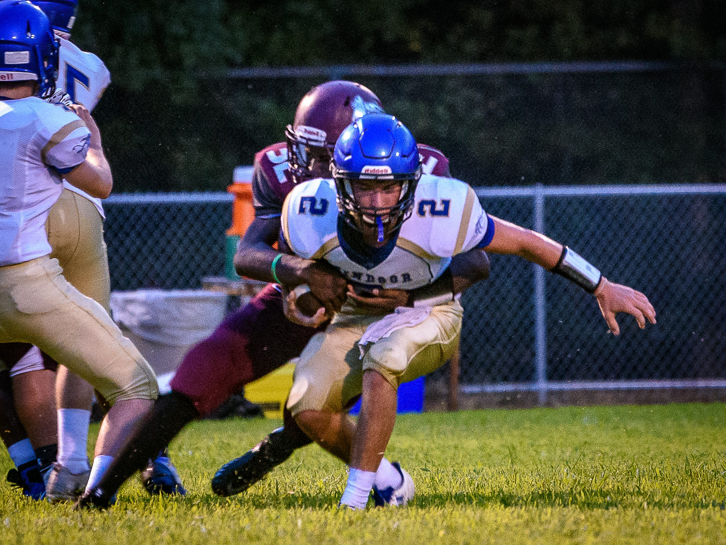 Windsor's Nicholas Donovan gets tackled by Nandua's Adrian Sample.