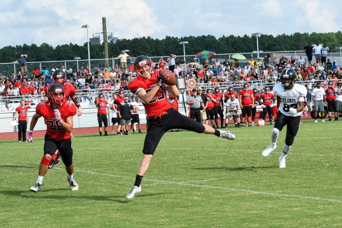 Bennett's Michael Harmon (23) catches an interception during a game against Colonel Richardson at JMB High School on Friday, Aug. 31, 2018.