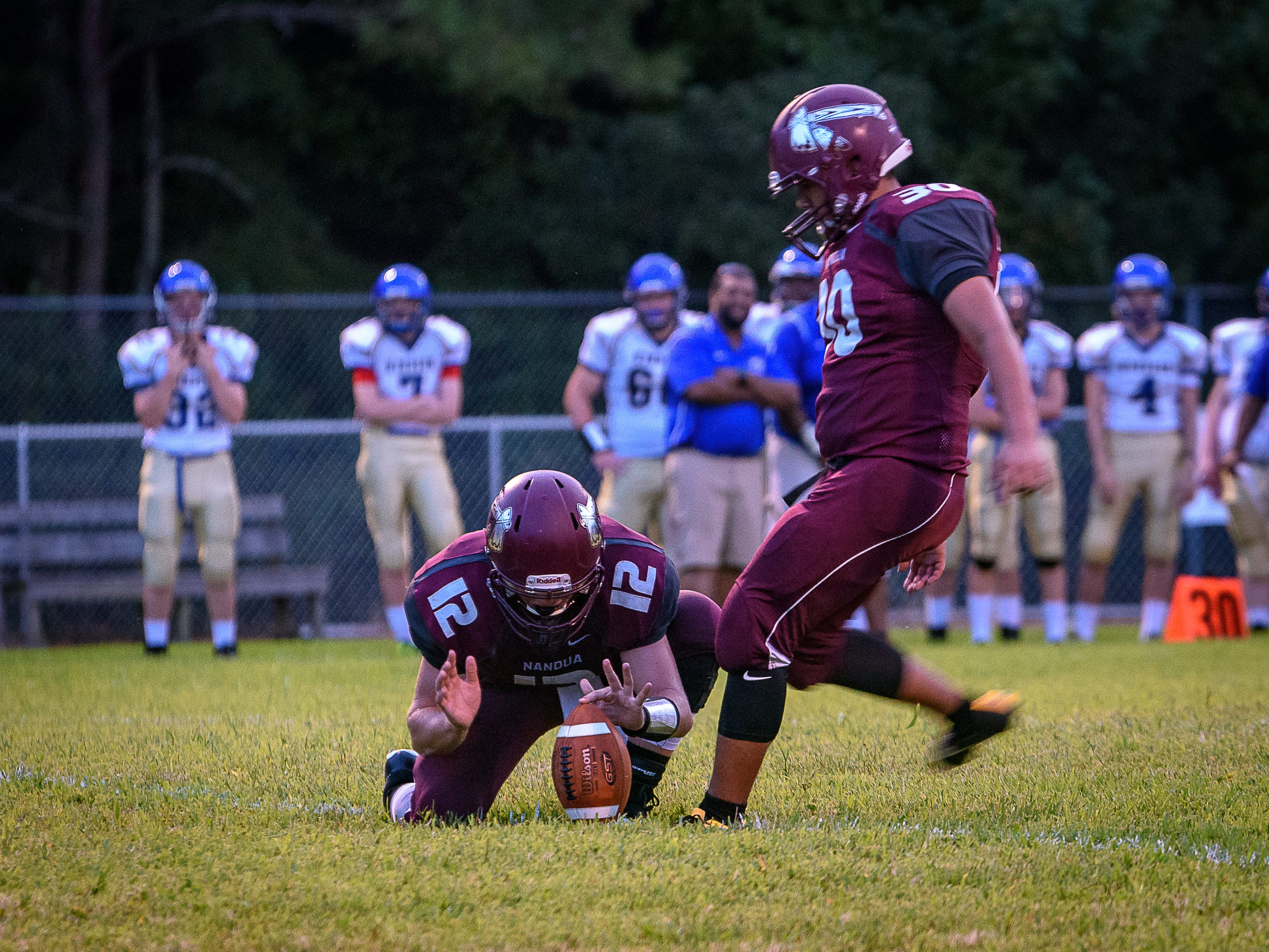 Nandua's Kristo Castillio kicks for the extra point as Joseph Teasley holds the ball.