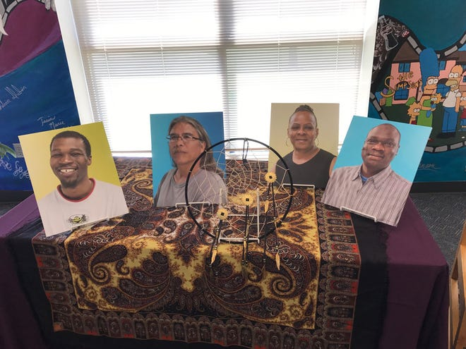 An example of artwork and photos on display at a recent Community United event.