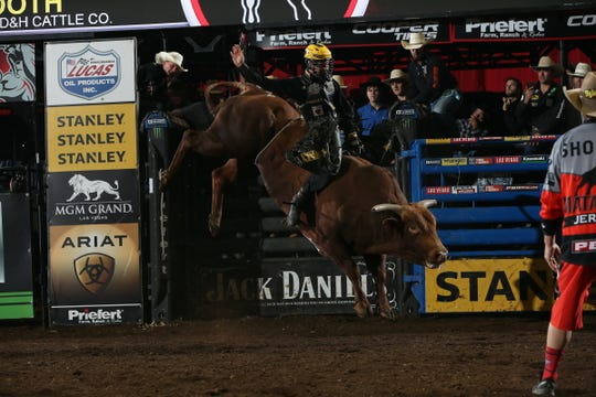 Jess Lockwood attempts to ride Too Smooth during the first round of the Springfield Built Ford Tough series PBR.