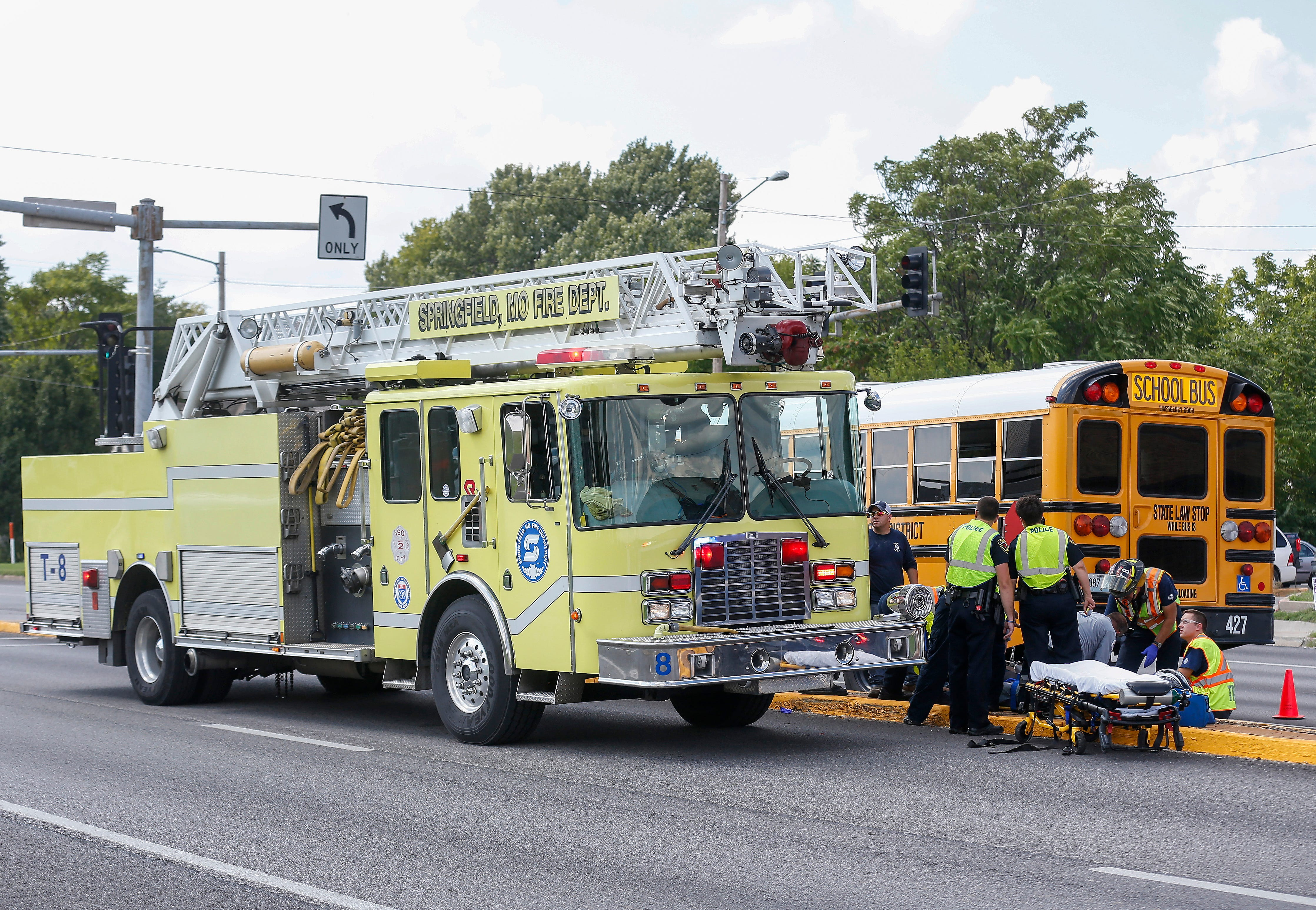 Police and emergency personnel work the scene of an accident at Chestnut Expressway and Grant Avenue involving a school bus and a motorcycle on Friday, Aug. 31, 2018.
