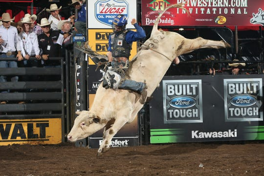 Kaique Pacheco rides McCoy Ranch's Opus during last year's PBR bull-riding competition at JQH Arena.
