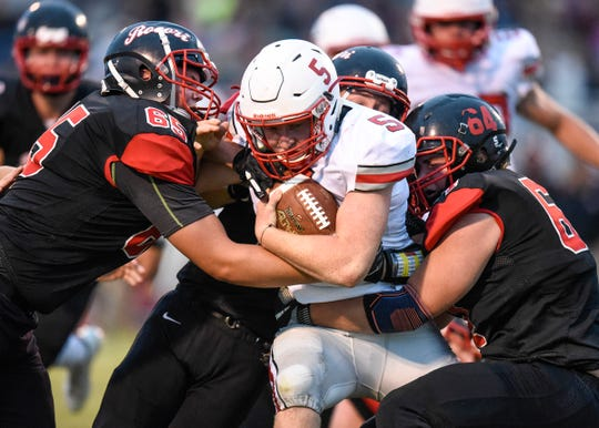 ROCORI players team up to tackle a Detroit Lakes rusher during the Thursday, Aug. 30, game in Cold Spring.
