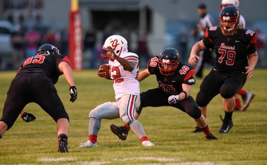 ROCORI players tackle Isaiah Thompson of Detroit Lakes during the Thursday, Aug. 30, game in Cold Spring.