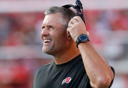 Utah head coach Kyle Whittingham looks at the scoreboard during the first half of the team's NCAA college football game against Weber State on Thursday, Aug. 30, 2018, in Salt Lake City. (AP Photo/Rick Bowmer)