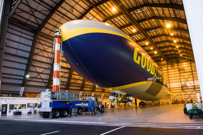 The Goodyear Finished Blimp Fully Revealed #MakeAName photoshoot at the at the Goodyear Airship Operations Blimp Base in Pompano Beach, Fla. on Monday, Feb. 5, 2018. (Mitchell Zachs/AP Images for Goodyear)