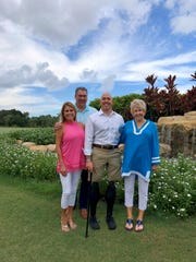 Congressman Brian Mast, center, with ARC of Martin County board members Maria Reich, left, Ed Kemm and Barbara Flowers.