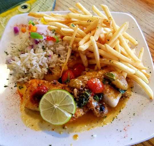 King Neptune's yellowfin grouper was  pan sauteed in garlic and white wine with blistered heirloom tomatoes and caramelized pearl onions. The sides were crispy shoestring fries and a fragrant coconut citrus rice .