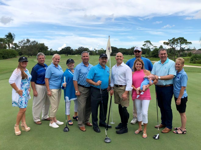 The ARC of Martin County Golf Committee with event guest speaker Congressman Brian Mast. Pictured are, from left, Catherine O'Connor, Roger Butterfield, Danielle Sexton-Wills, Barbara Flowers, Brian Reich, Keith Muñiz, Mast, Mike Eye, Maria Reich and baby Dylan, Ed Kemm and Barbara Vasquez.
