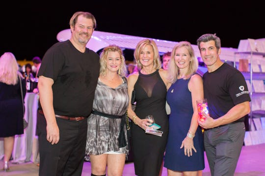 Dr. Alan Durkin, left, Kimberly Paul, Margaret Evans, Kristin Dobson and Chris Gurney at the 2017 Wine Women & Shoes  benefiting the Humane Society of Vero Beach & Indian River County at Sun Jet Aviation.