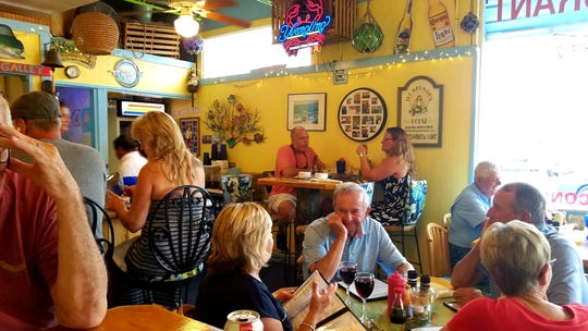 Colorful dining area at King Neptune's in port Salerno.