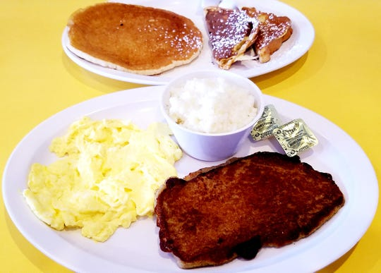 Aunt D's Breakfast Combo includes two eggs any style, choice of bacon, sausage, or ham, choice of home fries, hash browns, or grits, plus two pancakes or french toast.