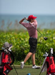 Vero Beach's Cade Coffey tees off on the fourth hole while practicing as his teammates compete with St. Edward's and Melbourne Central Catholic during the golf match Thursday, Aug. 30, 2018, at Riomar Country Club in Vero Beach.