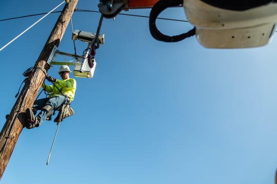 Crews install a Southern California Edison weather station in Simi Valley.