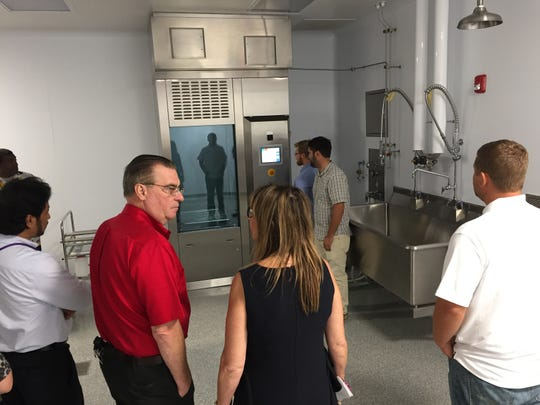 Cleanliness is a must at a pharmaceutical factory and this room inside the expanded Teligent factory in Buena Vista Township holds an automatic washing machine.