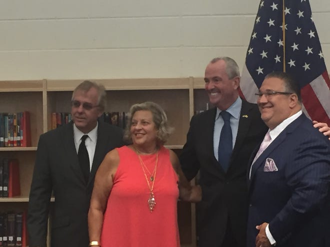 Gov. Phil Murphy celebrated a ribbon-cutting at Lincoln Avenue Middle School in Vineland on Aug. 31, 2018. He is pictured here in the school's media center with Wayne Weaver, the school district's facilities director, Superintendent Mary Gruccio and Mayor Anthony Fanucci.