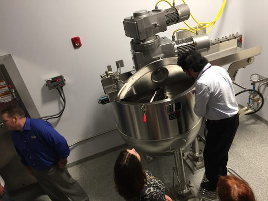 Buena Vista Township pharmeceutical company Teligent opened for touring its new factory addition on Friday. The expansion included new  processing equipment. This visitor is watching the churning action inside what the industry calls a Lee Kettle.