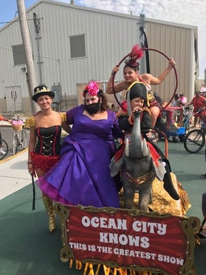 "Ryan, 6, and Angelina, 11, Medio of Vineland won Division C of Ocean City's 109th baby parade with their entry, ""Ocean City Knows This Is The Greatest Show."" Shown with the float are (from left) Rachel Hoffman of Millville, and Lisa Rosario, and Ryan and Angelina Medio, all of Vineland."