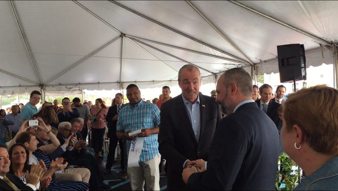 Gov. Philip Murphy shakes hands with Jason Grenfell-Gardner, president and chief executive officer of Teligent, following a ribbon-cutting ceremony Friday to dedicate the Buena Vista Township-based pharmaceutical company's factory expansion.
