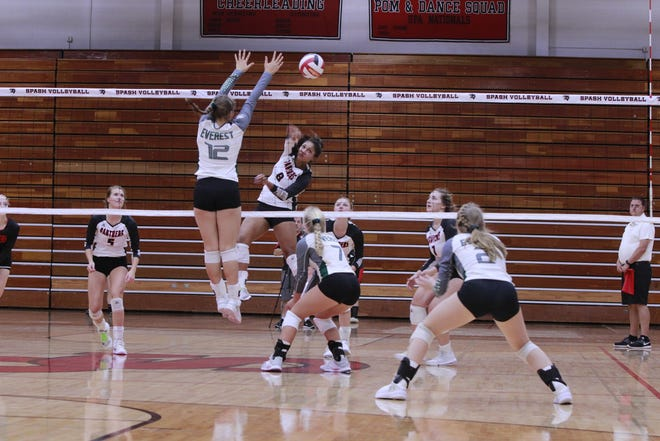 A SPASH hitter goes around a block to get a kill during a game against DC Everest.