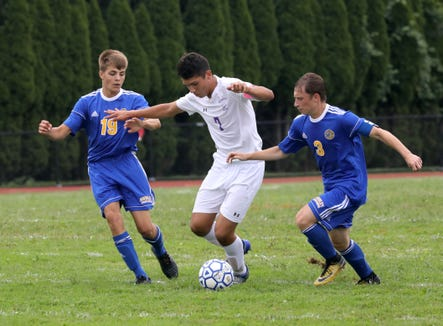 Ardsley's Pierce Dillon, New Rochelle's Johan Velez and Ardsley's Samuel Hirth in action during their boys soccer game at Ardsley High School, Aug. 31, 2018.